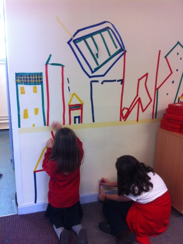 Designing a city with electrical tape, corridor installation with 90 yr 3 children.